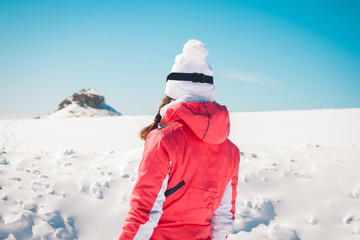 Woman explorer skier looking the snowy horizon