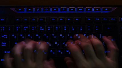 Russian Hacker Typing On Backlit Keyboard, time lapse