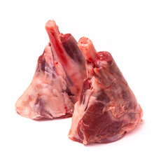 Goat meat shanks isolated on a white studio background.