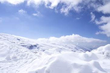 Panorama of Snow Mountain Range Landscape with Blue Sky
