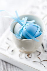 Two easter eggs in a tea cup