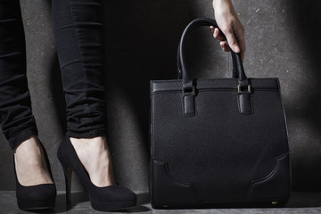 Woman in high heels and handbag