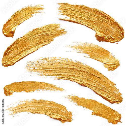 Strokes of golden paint - 78703415