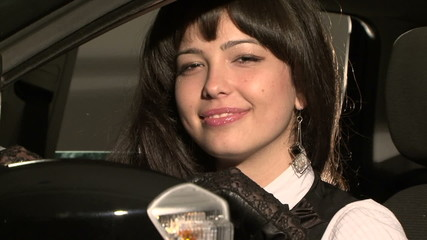 Young Pretty Woman In Car