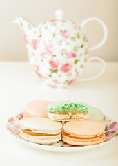 Macarons against tea set with retro filter effect