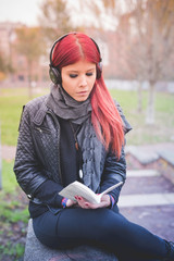 young beautiful red hair venezuelan woman lifestyle listening mu