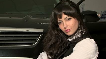 Young Beautiful Woman With Long Black-Hair Looking At Camera