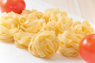 Tagliatelle (nests) with tomatoes