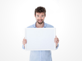 smiling young man holding an empty board