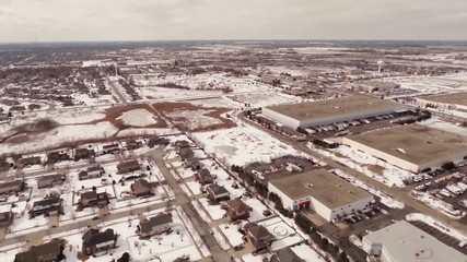 Aerial of homes in a snow covered suburban neighborhood