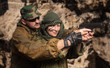 Portrait of the woman to trained bullet shooting with instructor