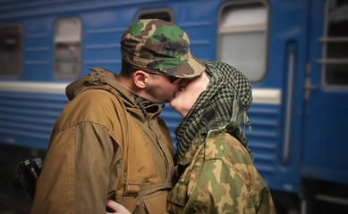 Romantic scene of farewell of wife with husband leaving on milit