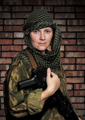 Portrait of the woman of the soldier with an automatic assault r