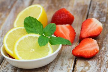 Lemon and strawberries, source of vitamin C