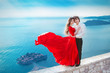 Romantic young couple in love. Fashion girl model in blowing red