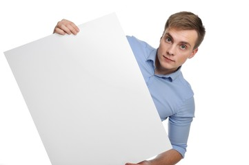 Young man holding white empty paper.