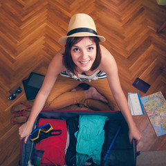 Packing Suitcase And Getting Ready For Traveling