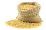 unpolished rice (whole grain) in a burlap bag on a white backgro poster