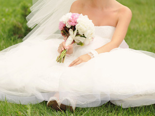 Bride with Bouquet on Grass