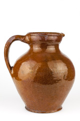 Old clay jug isolated