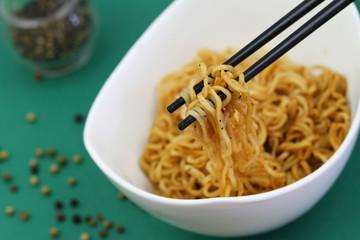 Chinese noodles on chopsticks, closeup