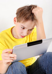 Stressed Kid with Tablet Computer