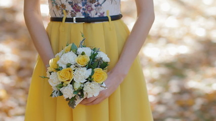 Nice yellow bouquet in girls arms