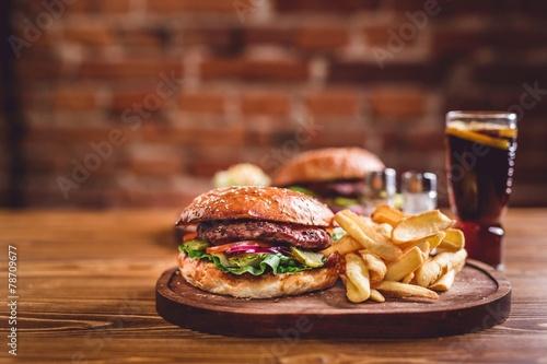 Fotobehang Restaurant Fresh burger on wooden table.