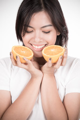 Young woman holding fresh oranges. Healthy eating. Isolated over