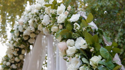 Wedding arch with natural roses