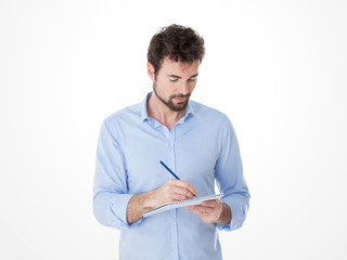 young man taking notes in a conference