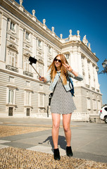young beautiful tourist girl in Spain taking selfie picture