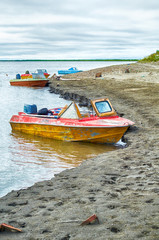 Old motor boats on the bank of river Indigirka  in north yakutia