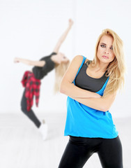 Hip hop dancers training on light background