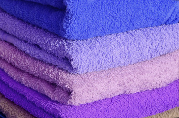 Stack of blue and purple towels