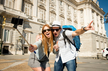 tourist couple visiting Spain in students exchange taking selfie