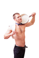 Attractive man holding a towel and frying pan