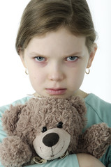 Portrait of  little girls cry holding teddy bear on white