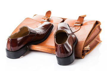 Shoes and bag on white background.