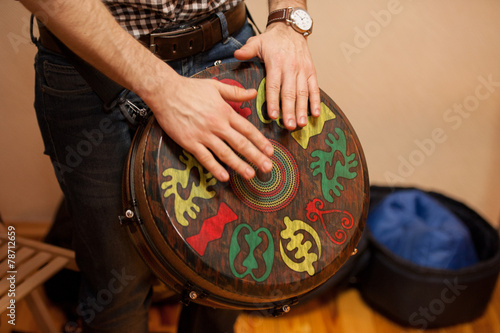 Leinwanddruck Bild person playing on Jambe Drum no face