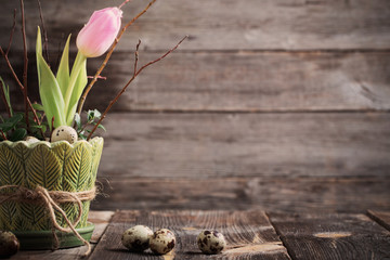 Easter decoration on old wooden background