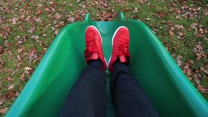 Unrecognizable person coming down a Slide