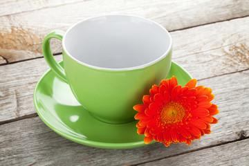 Coffee cup and gerbera