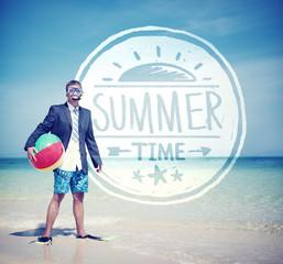Businessman Holding Beach Ball Standing on the Beach