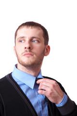 Attractive business man straightens his tie