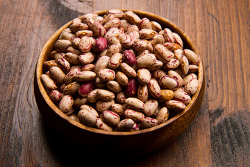 pinto beans on wood bowl