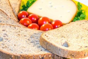 Plate with bread, fresh tomatoes and cheese