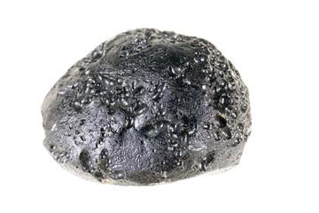 Tektyt  stone or meteorite mineral on a white background