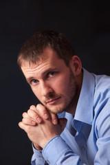 Fashion young man in blue shirt