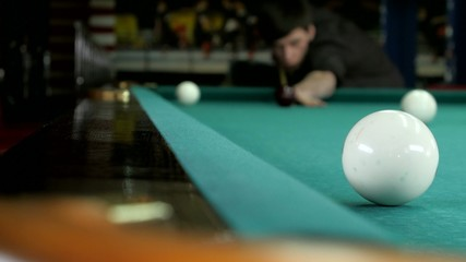 The young man gets into a billiard pocket.